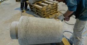 Bush-hammering on a stone bollard
